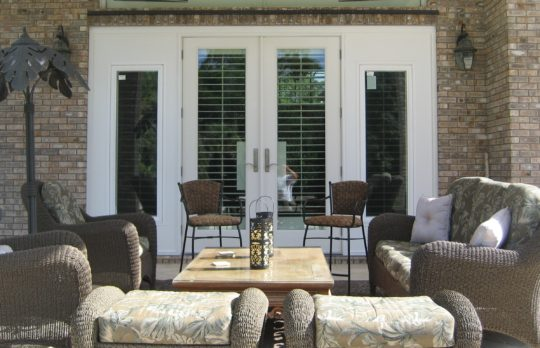 beautiful-outdoor-living-space-impact-ready-doors-and-glass